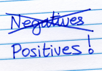 Crossing out negatives and writing positives.