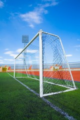 STADIUM - Football field with goal on blue sky