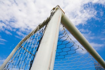 STADIUM - Football goal corner on blue sky