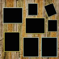 vintage frames on wooden background