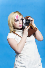 Blond girl with retro camera look aside