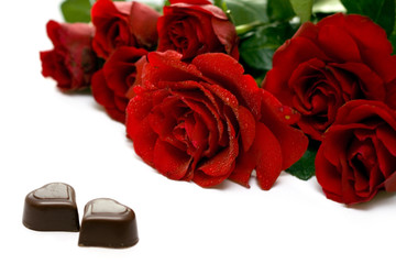 Red rose and chocolate hearts isolated on white