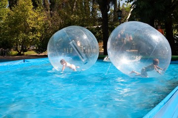 Children in the water-ball