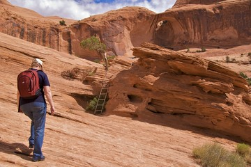 Hiker on Corona Arch Trail, Moab, just outside Arches NP