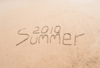 "Inscription on wet sand ""Summer 2010"""