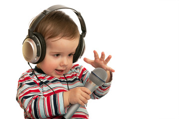 Speaking toddler with headphones and microphone