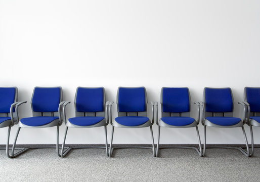 Blue chairs in ordinary empty waiting room