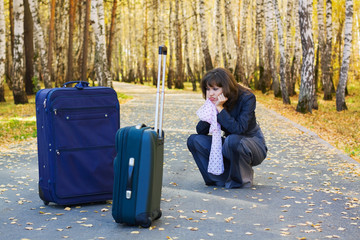 Sad businesswoman with a luggage.