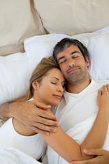 Loving couple sleeping