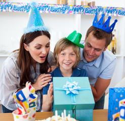 Loving parents celebrating their son's birthday