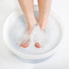 Feet of boy in foot bath