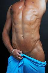 Muscled male torso with blue textile