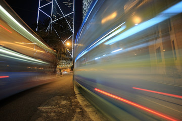Bus speeding through night street. Hong Kong, China
