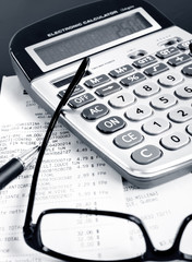 Calculator, pen, bills