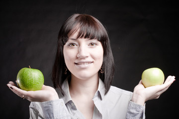 smiling woman with green apples in hands