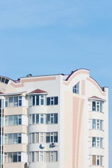 Part of new multistoried residential building with blue sky