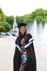 Beautiful graduation girl in cap and gown