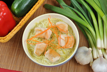 asian style noodle chicken soup with carrot