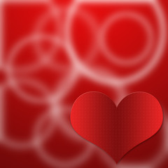 Red glossy heart on red background