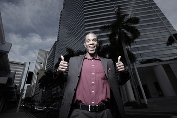 African American businessman showing thumbs-up