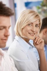 Happy businesswoman in boardroom