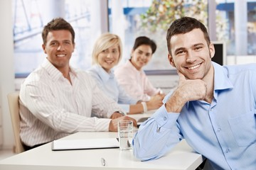 Happy businessman on meeting