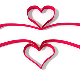 two red ribbon as heart shape