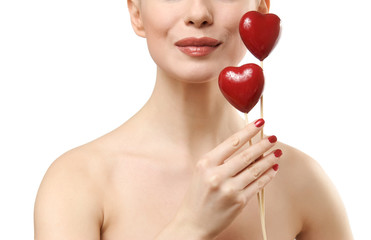 Beautiful woman holding two red hearts.