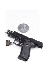 Pistol on the raked target