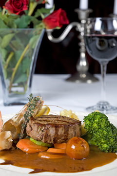 Surf 'n' turf a la carte meal with red wine