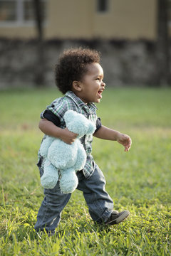 Young toddler walking through a field