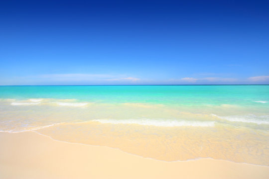 Idyllic beach with white sand and turquoise blue waters