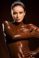 amazing shot of a young beautiful brunette with her naked body c