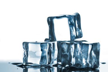 ice cubes with water drops on white