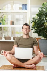 Meditation with laptop computer