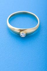 Gold ring on blue macro