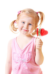 girl with candy in form heart isolated on white