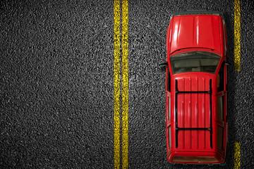 The red car on asphalt