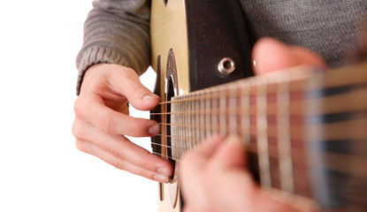 Close up of guitarist hand playing guitar