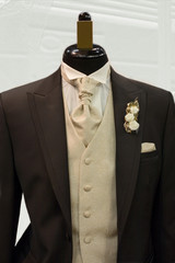 brown tie and black suit on shop mannequins