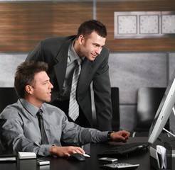 Businessmen working with computer