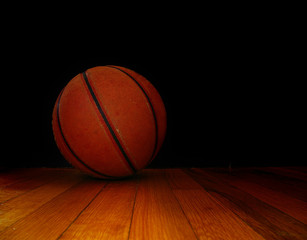 a basket ball on the court, over dark background