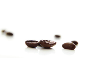 assorted coffee beans, macro on white