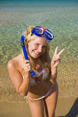Young happy beautiful summer diving woman with mask