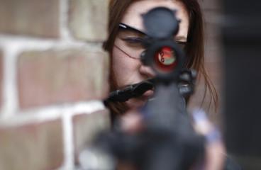 woman aiming rifle