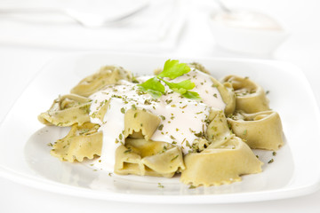 dish of tortellini with cheese sauce