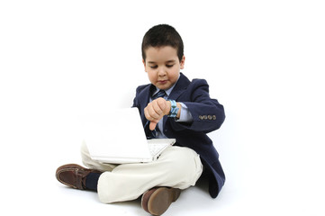 Little businessman with laptop looking at his watch