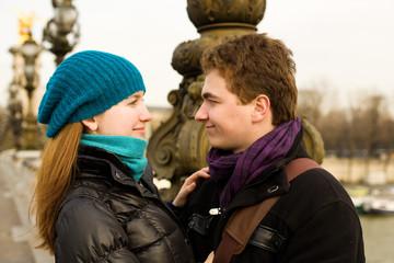 Romantic loving couple in Paris, looking in each others eyes