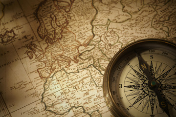 vintage compass on a map