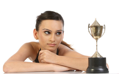 Young woman seeing her gold trophy